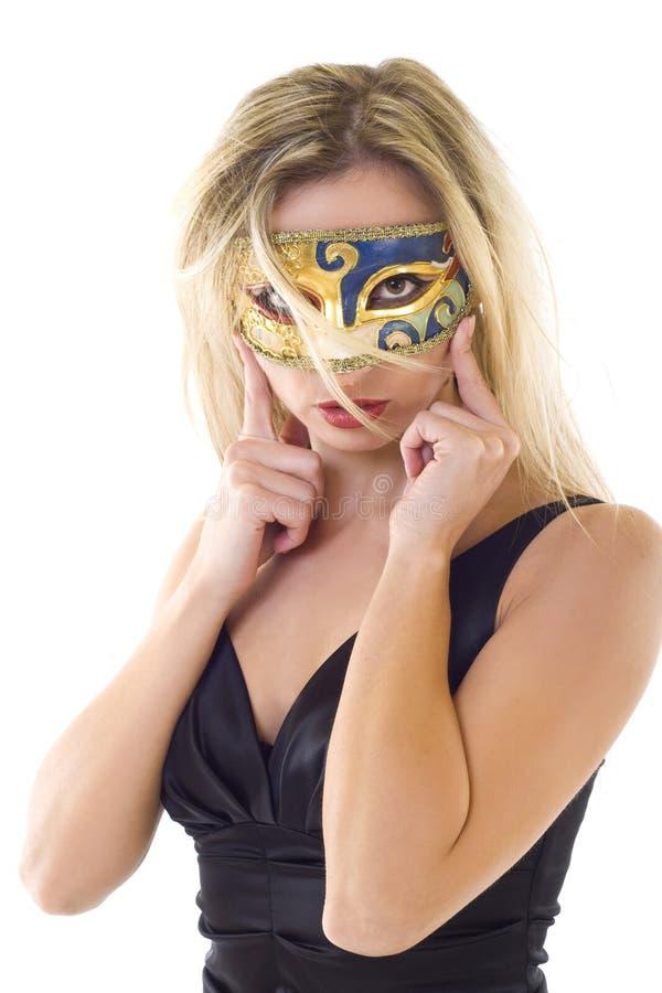 Mujer joven en máscara del carnaval fotos de archivo