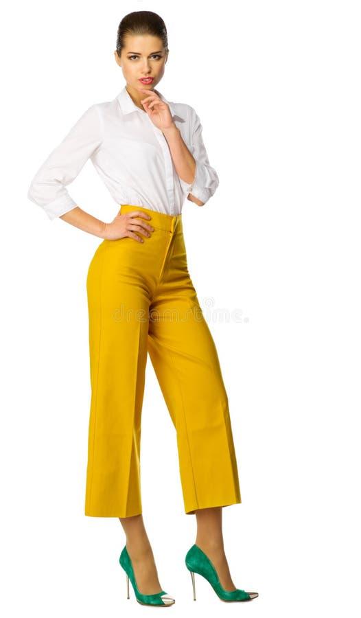 Mujer Joven En Pantalones Amarillos Foto De Archivo Imagen De Amarillos Mujer 72065612