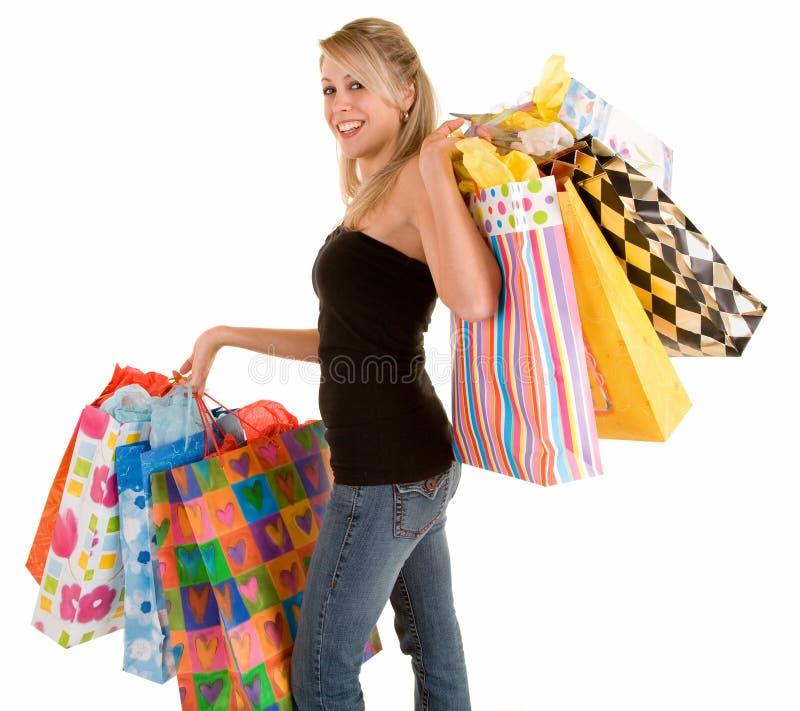 Mujer joven en una juerga de compras imagen de archivo
