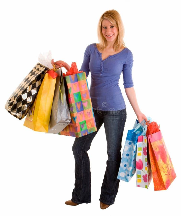 Mujer joven en una juerga de compras imágenes de archivo libres de regalías