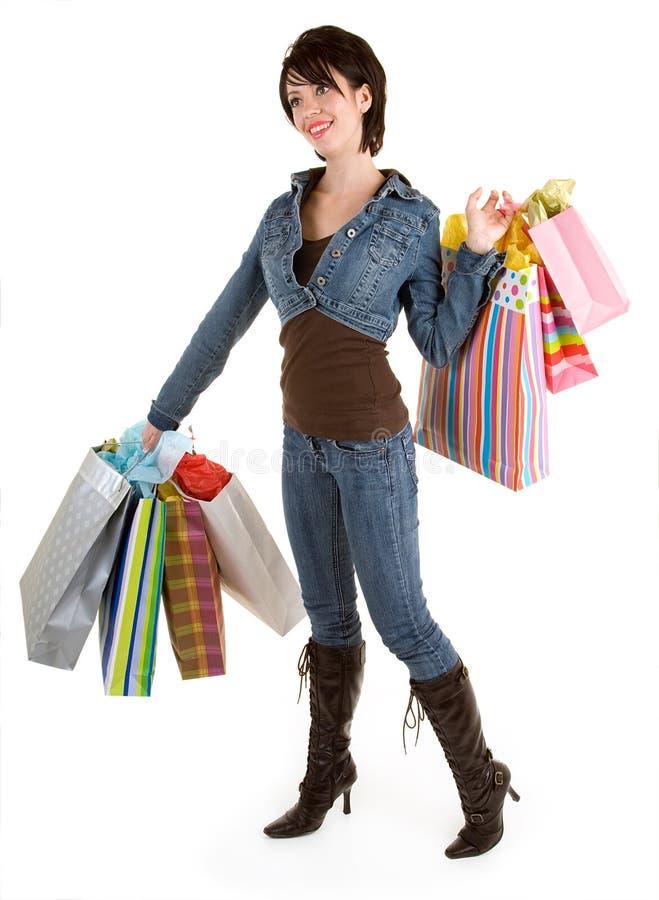 Mujer joven en una juerga de compras fotos de archivo