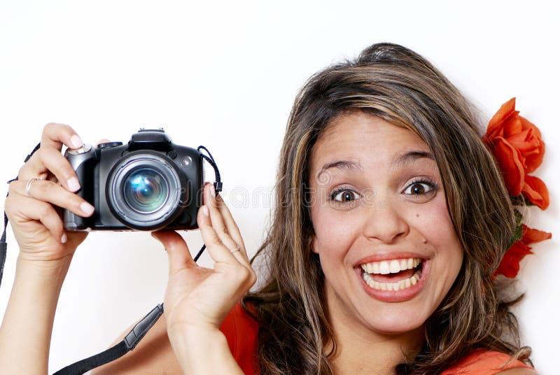 Mujer joven feliz con la cámara imagen de archivo