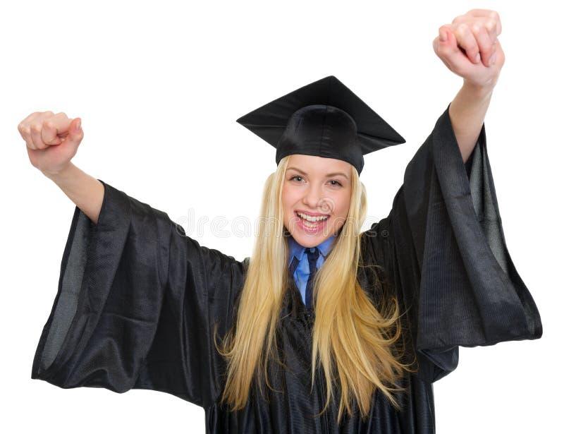 Mujer feliz en éxito del júbilo del vestido de la graduación fotos de archivo libres de regalías