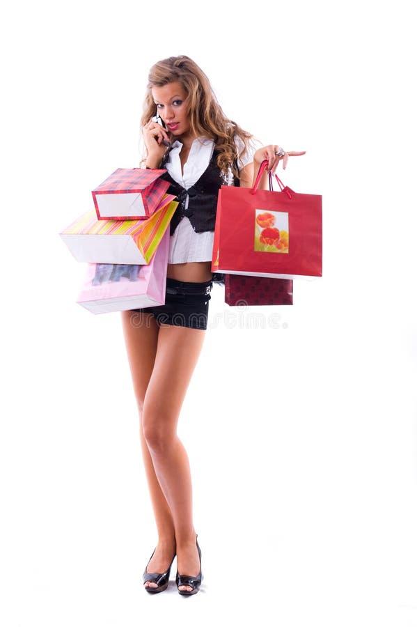 Mujer joven feliz en una juerga de compras. fotografía de archivo