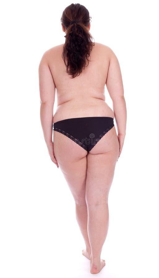 Mujer joven gorda en bragas negras imagen de archivo libre de regalías