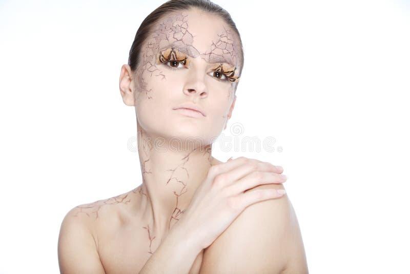 Mujer joven hermosa con el facepaint stylezed fotos de archivo