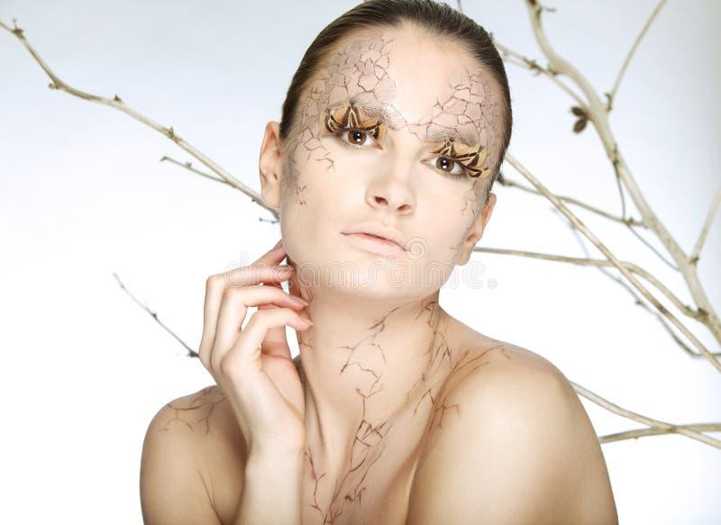 Mujer joven hermosa con el facepaint stylezed imagen de archivo libre de regalías