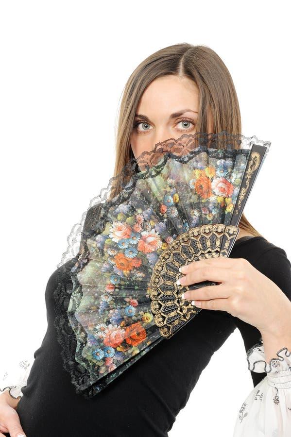 Mujer joven hermosa con el ventilador foto de archivo