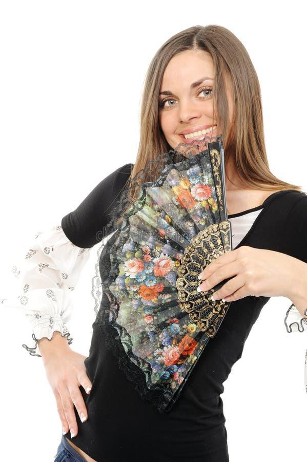 Mujer joven hermosa con el ventilador imagen de archivo libre de regalías