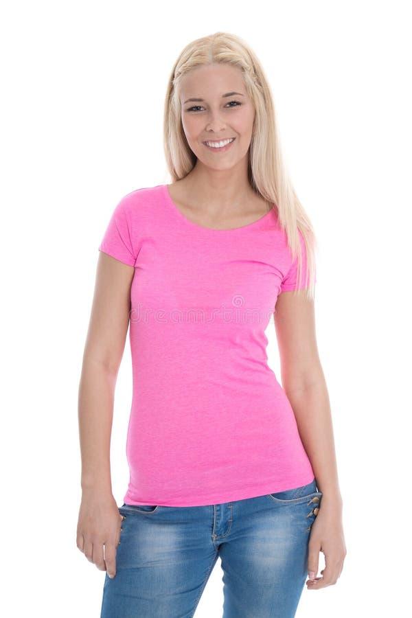 Mujer joven hermosa en camisa color de rosa y los tejanos aislados. fotos de archivo libres de regalías