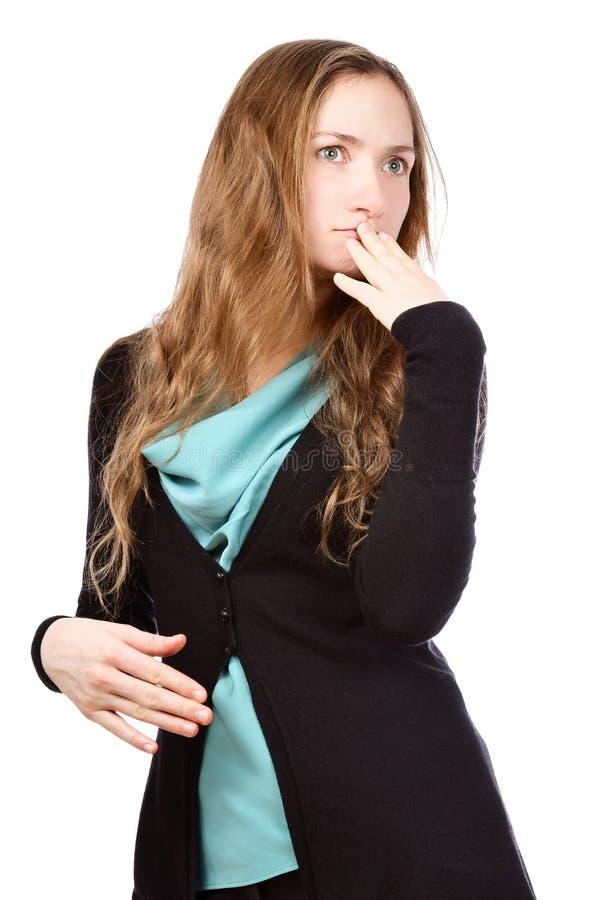 Mujer joven hermosa que mira a un lado fotografía de archivo libre de regalías