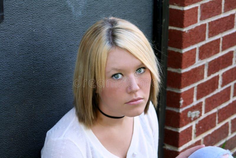Mujer joven infeliz fotografía de archivo