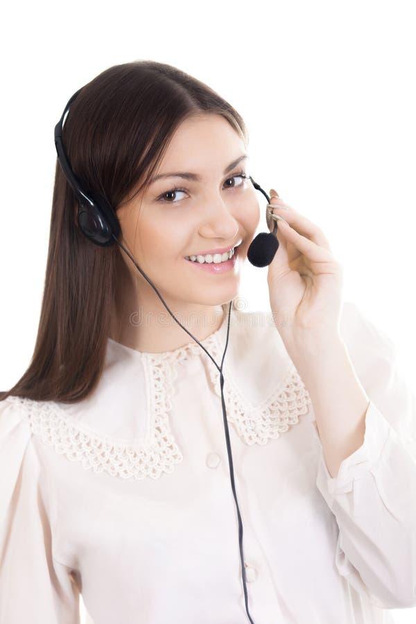 Mujer joven, operador de centro de atención telefónica con las auriculares en el backgrou blanco imagenes de archivo