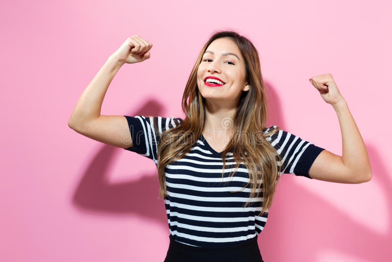Mujer joven potente fotos de archivo libres de regalías