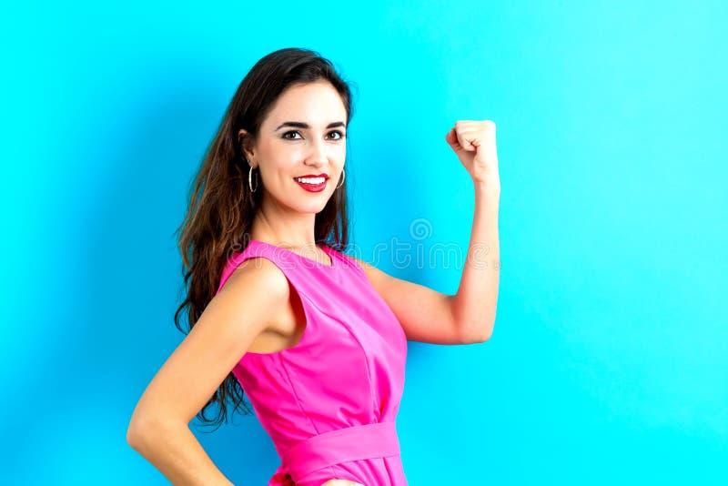Mujer joven potente imagenes de archivo