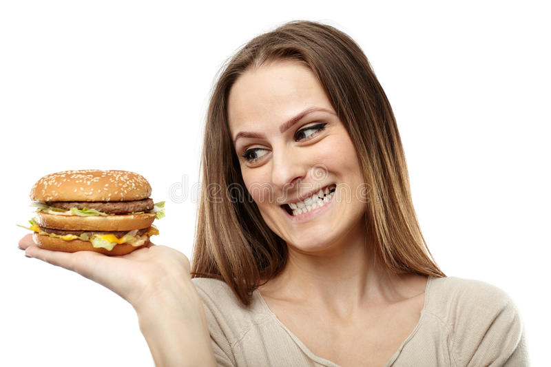 Mujer joven que anhela una hamburguesa fotos de archivo