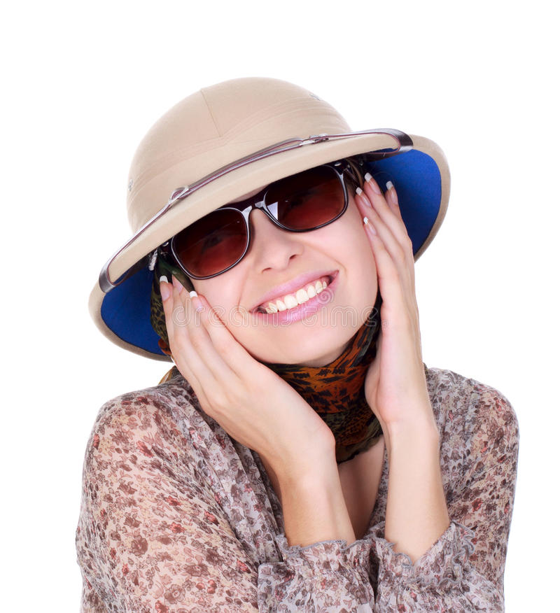 Mujer joven que desgasta un safari del casco fotografía de archivo libre de regalías