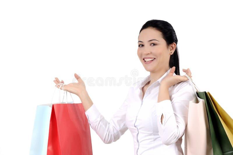 Mujer joven que hace compras fotografía de archivo libre de regalías