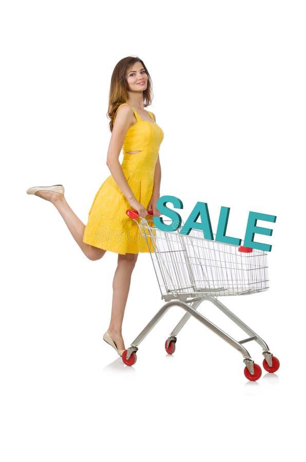 Mujer joven que hace las compras aisladas en blanco imagen de archivo libre de regalías