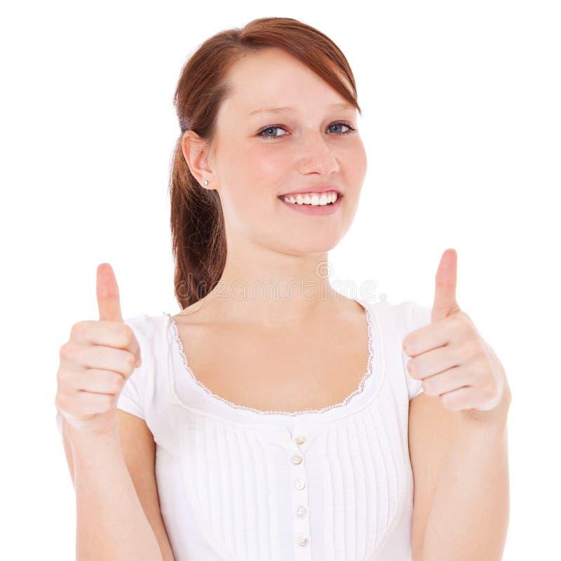 Mujer joven que muestra los pulgares para arriba imagen de archivo libre de regalías