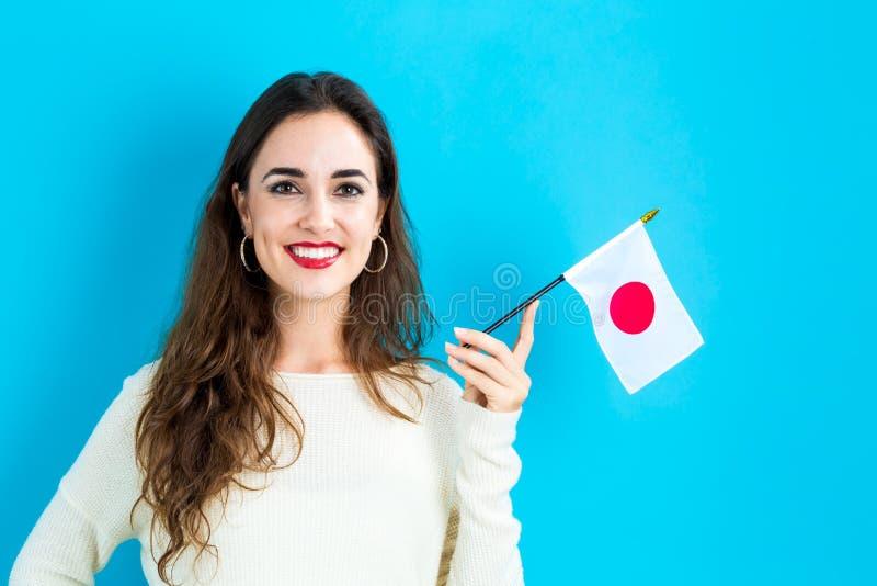 Mujer joven que sostiene el indicador japonés fotografía de archivo