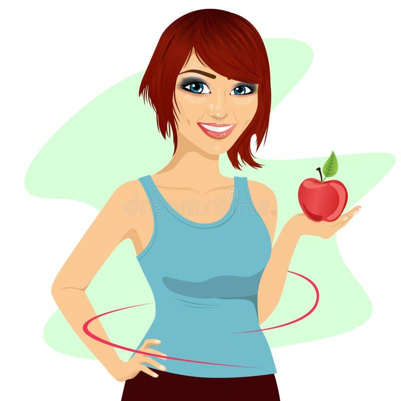 Mujer joven que sostiene una manzana roja que muestra la cintura fina stock de ilustración