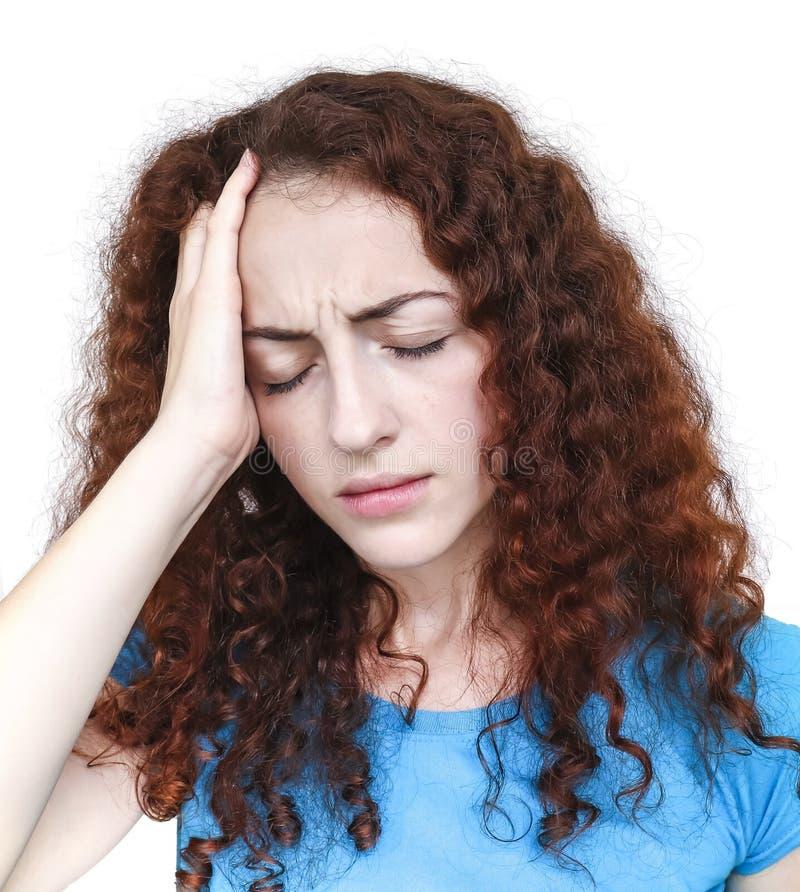 Mujer joven que tiene dolor de cabeza fotos de archivo
