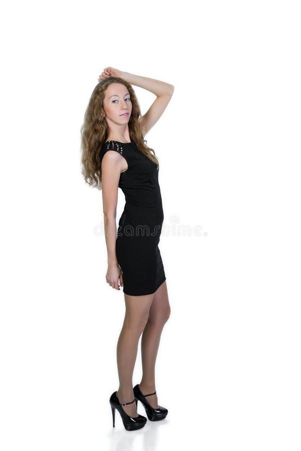Mujer joven rubia en un fondo blanco fotos de archivo
