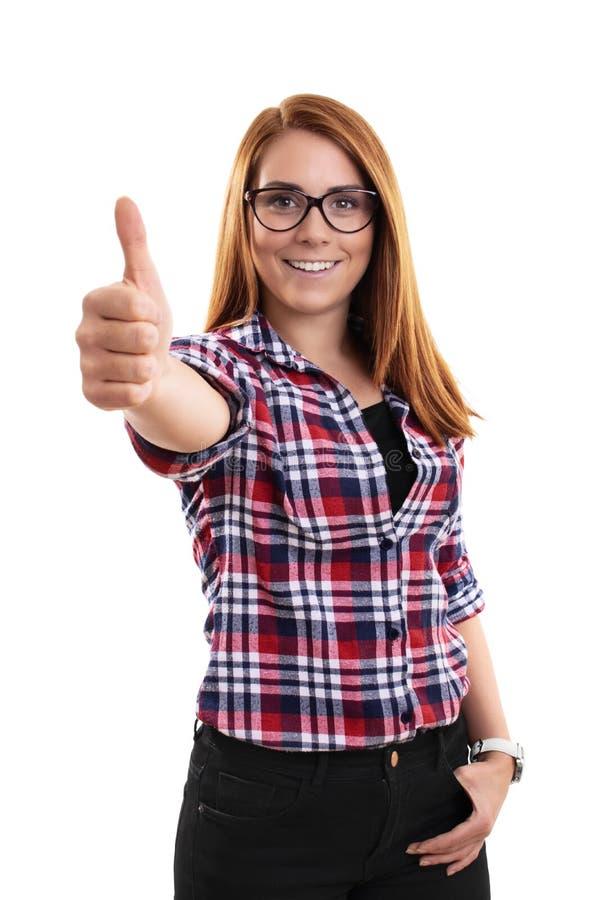 Mujer joven sonriente que da la aprobación con los pulgares para arriba imágenes de archivo libres de regalías
