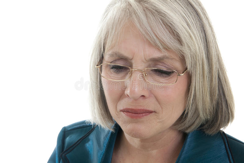 Mujer madura triste imagenes de archivo