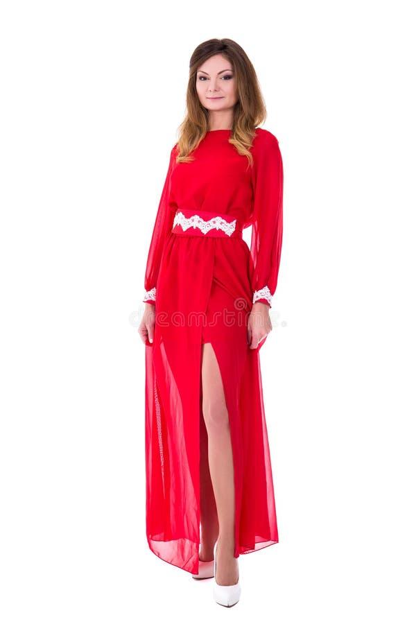 Mujer magnífica joven en el vestido rojo aislado en blanco fotos de archivo libres de regalías