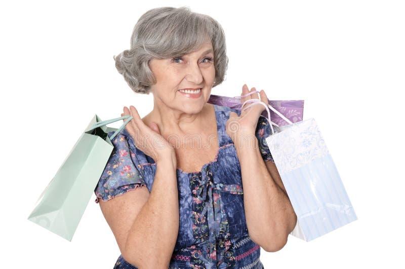 Mujer mayor agradable con el panier fotos de archivo libres de regalías