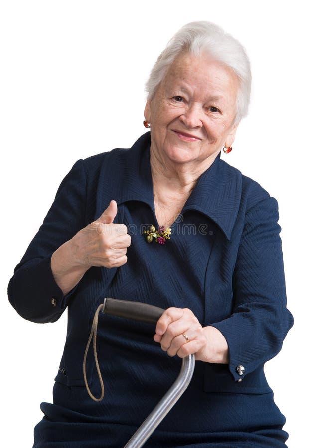 Mujer mayor con un bastón imagenes de archivo