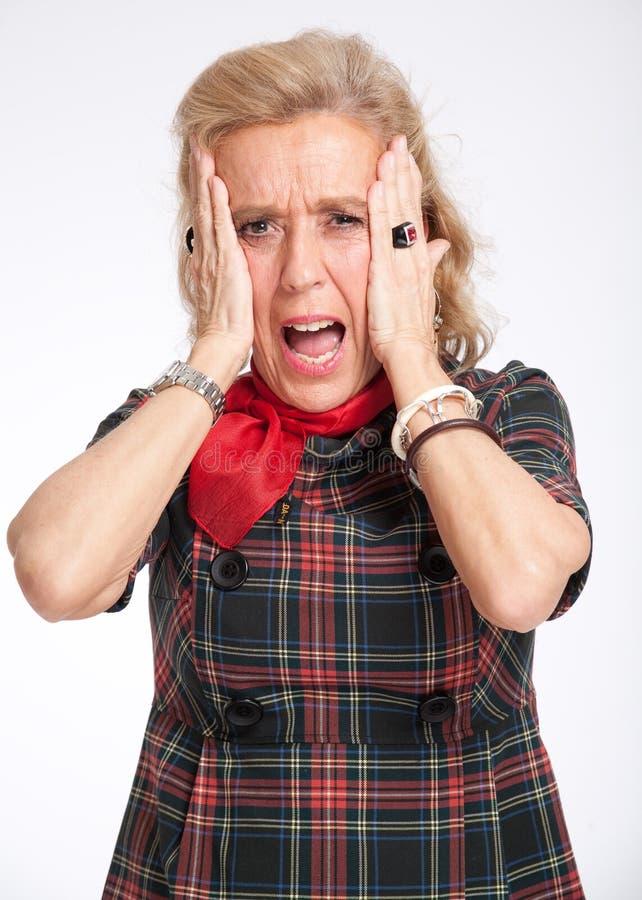 Mujer mayor horrorizada foto de archivo libre de regalías