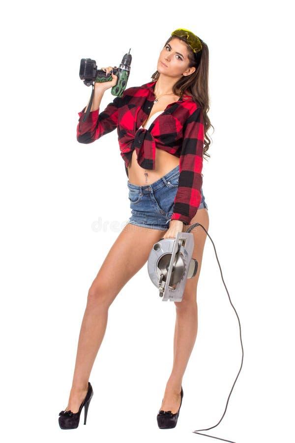 Mujer morena atractiva joven del constructor foto de archivo libre de regalías