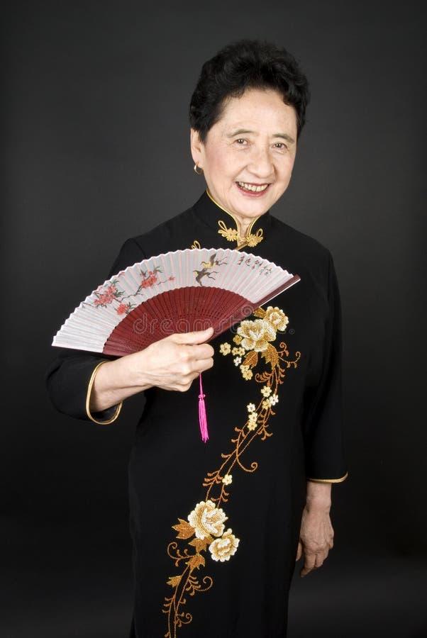 Mujer oriental madura fotos de archivo