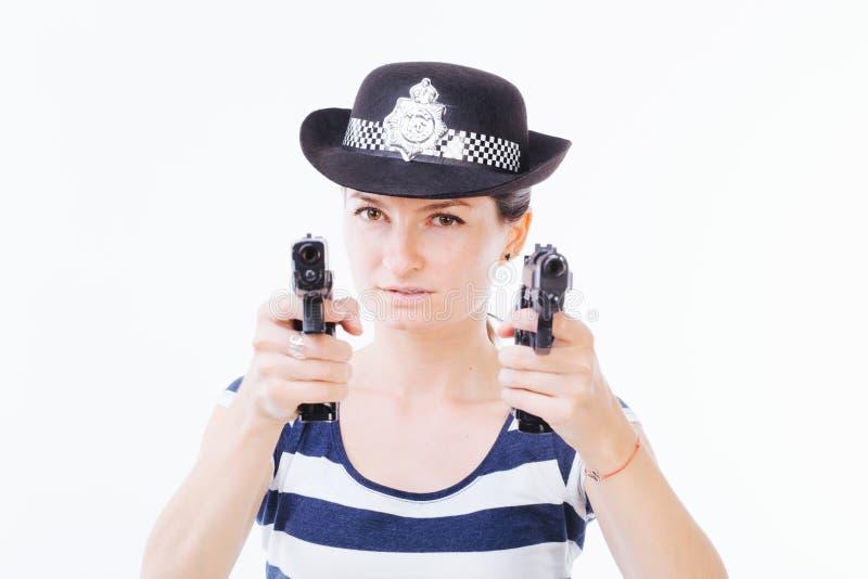 Mujer peligrosa con los armas foto de archivo libre de regalías