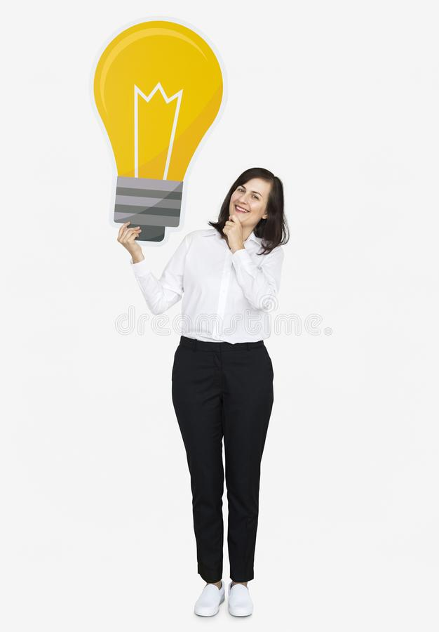 Mujer pensativa con un icono de la bombilla fotos de archivo