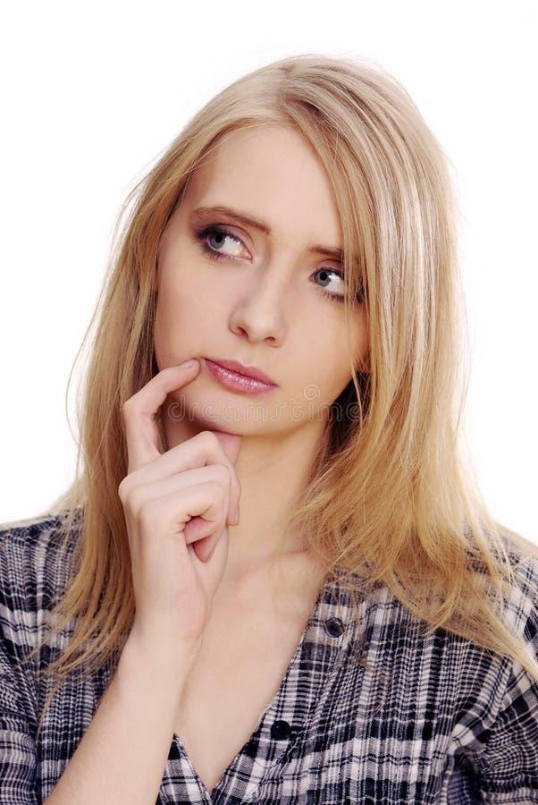 Mujer pensativa joven imagen de archivo libre de regalías