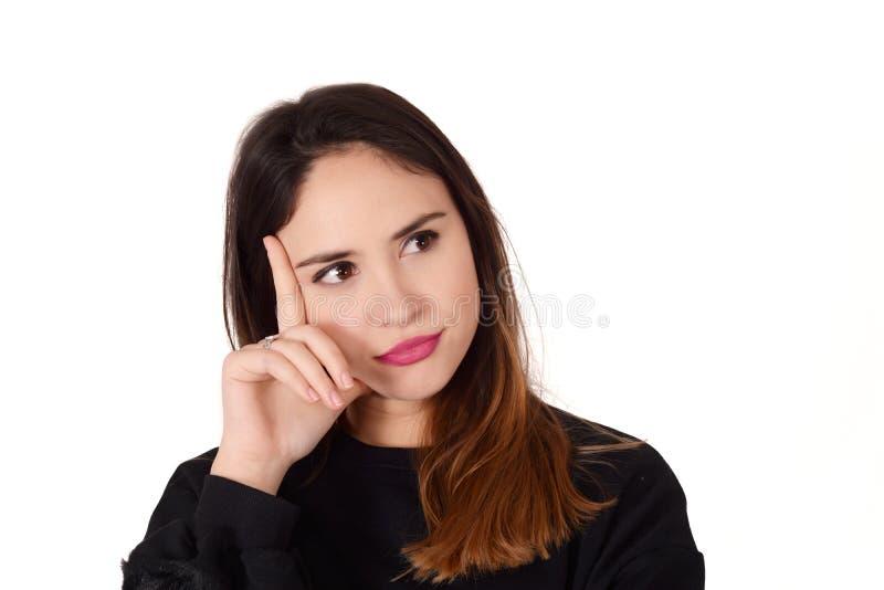 Mujer pensativa joven con la mano en su ji fotografía de archivo libre de regalías