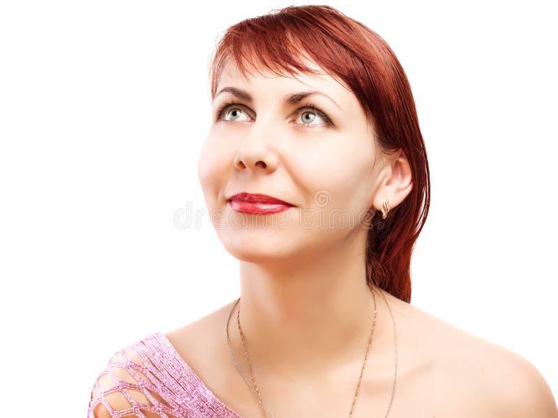 Mujer pensativa que mira para arriba foto de archivo libre de regalías