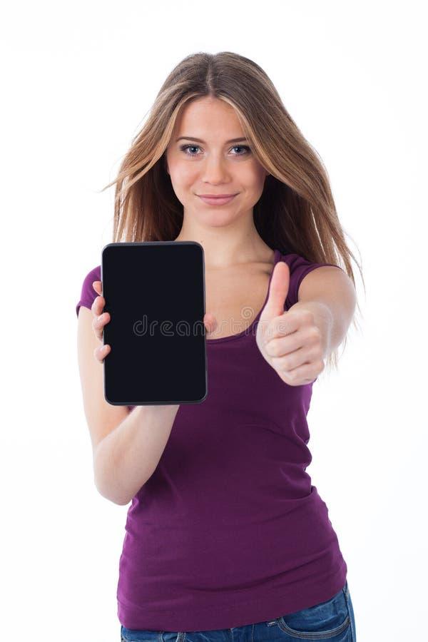 Mujer positiva que sostiene un panel táctil imágenes de archivo libres de regalías