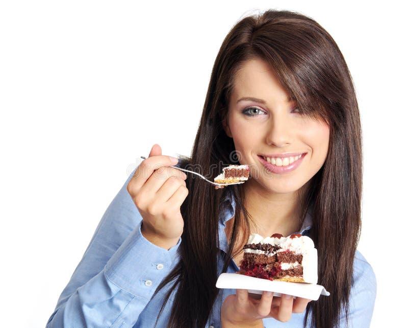 Mujer que come la torta imágenes de archivo libres de regalías