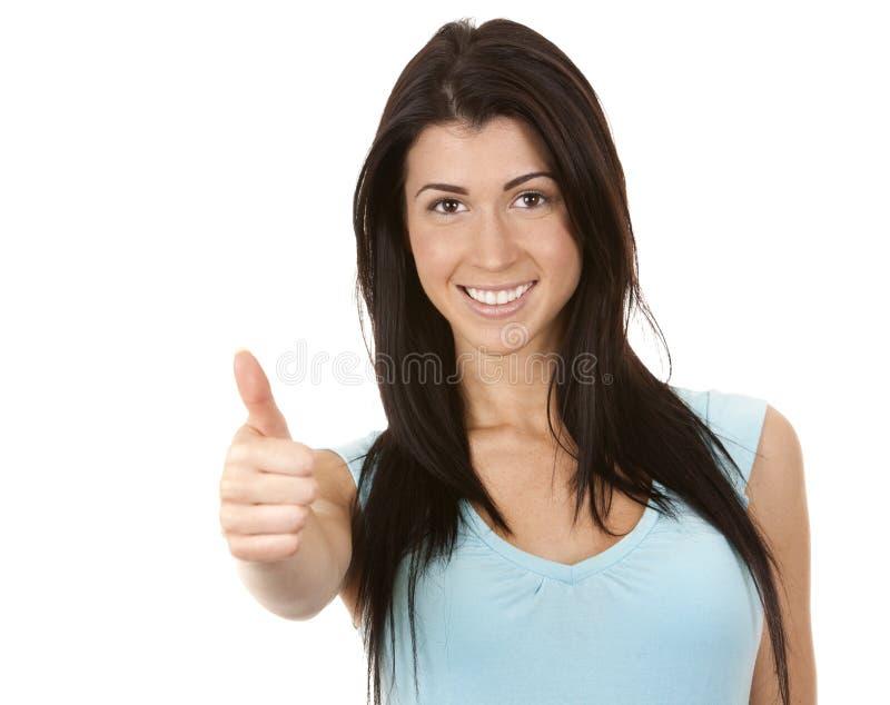 Mujer que da el pulgar para arriba fotografía de archivo libre de regalías