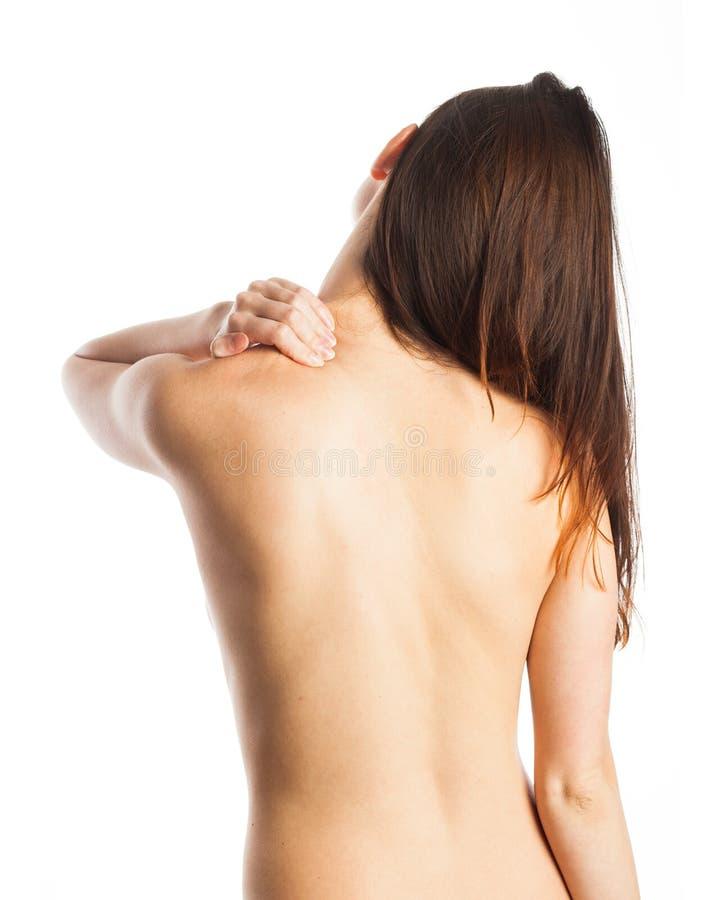 Mujer que da masajes a su cuello foto de archivo libre de regalías