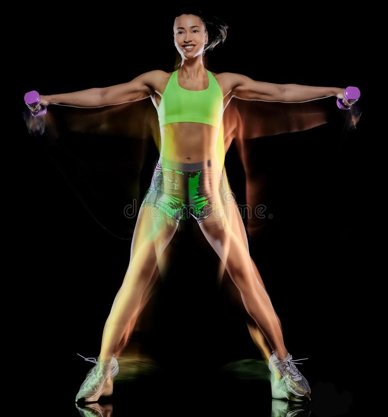 Mujer que ejercita efecto lightpainting aislado ejercicios del fondo negro de la aptitud fotos de archivo libres de regalías