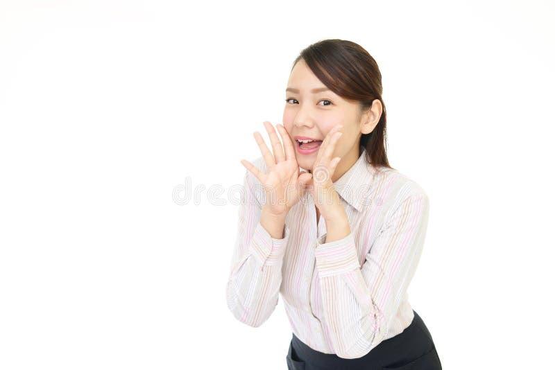 Mujer que está animando fotos de archivo