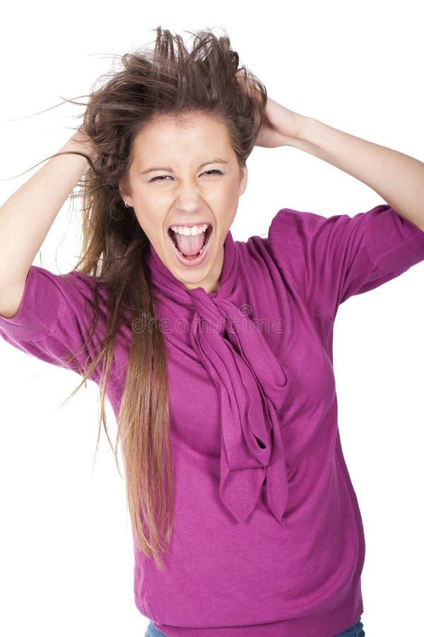 Mujer que grita y que tira del pelo imagenes de archivo