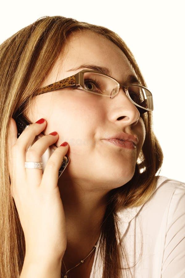 Mujer que habla del teléfono imagen de archivo libre de regalías