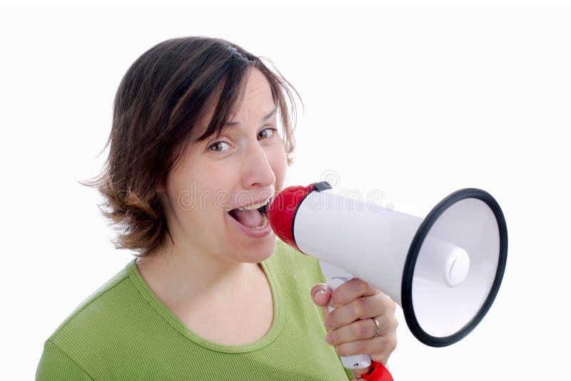 Mujer que habla en un megáfono fotografía de archivo